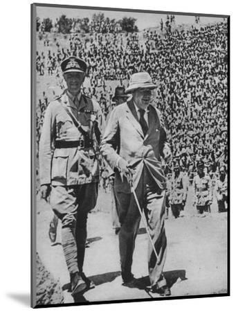 'Home via the Battlefields - Mr Churchill in the ancient Roman amphitheatre at Carthage', 1943-44-Unknown-Mounted Photographic Print