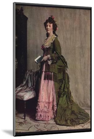 'An afternoon dress of green and pink silk. Very typical of the modes between 1868 and 1878', c1913-Unknown-Mounted Photographic Print