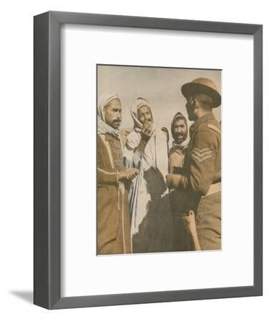 'Tunisian Arabs Welcome a British Sergeant at Chaouach', 1943-Unknown-Framed Photographic Print