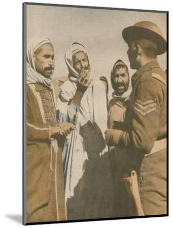 'Tunisian Arabs Welcome a British Sergeant at Chaouach', 1943-Unknown-Mounted Photographic Print
