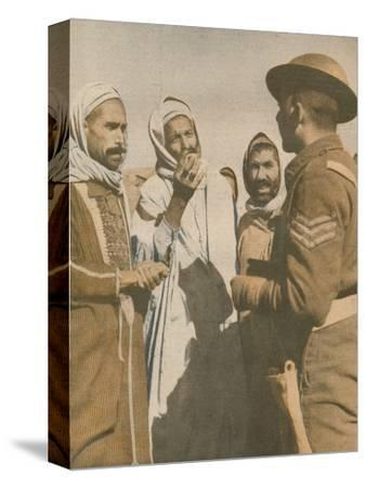 'Tunisian Arabs Welcome a British Sergeant at Chaouach', 1943-Unknown-Stretched Canvas Print