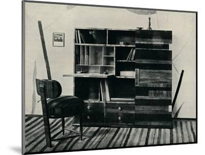 'Bookcase and Chair. Designed and executed by Hans Hartl', c1927-Unknown-Mounted Photographic Print