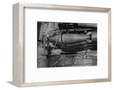 Heavy bombs in the racks of a RAF Short Sunderland flying boat, c1940 (1943)-Unknown-Framed Photographic Print