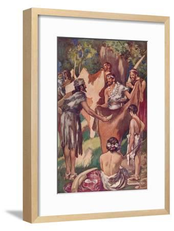 The beginnings of commerce: primitive people bartering ivory tusks and bull hides, 1907-Unknown-Framed Giclee Print