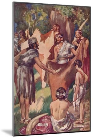 The beginnings of commerce: primitive people bartering ivory tusks and bull hides, 1907-Unknown-Mounted Giclee Print