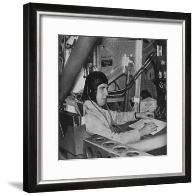 RAF flight engineer on board an aircraft, c1940 (1943)-Unknown-Framed Photographic Print