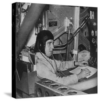 RAF flight engineer on board an aircraft, c1940 (1943)-Unknown-Stretched Canvas Print