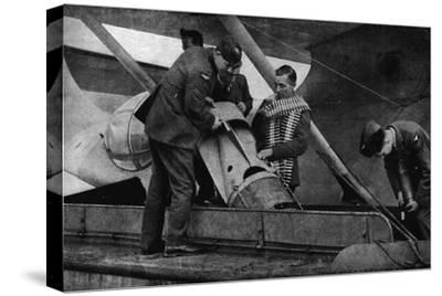 Loading bombs on to an RAF aircraft during World War II, c1940 (1943)-Unknown-Stretched Canvas Print