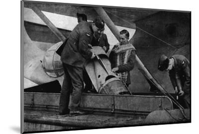 Loading bombs on to an RAF aircraft during World War II, c1940 (1943)-Unknown-Mounted Photographic Print