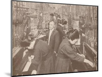 The busy interior of a flourishing silk factory in Japan, 1907-Unknown-Mounted Photographic Print