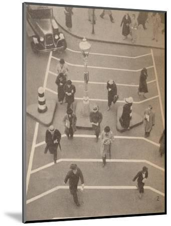 'A Safety Lane opposite Charing Cross Station', c1934, (1935)-Unknown-Mounted Photographic Print