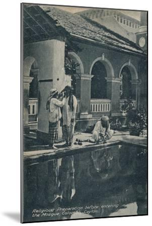 'Religious Preparation before entering the Mosque, Colombo, Ceylon', c1910-Unknown-Mounted Giclee Print