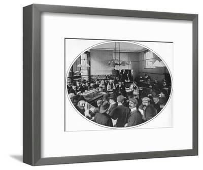 Sale of unredeemed goods at Debenham, Storr and Sons auction rooms, London, c1903-Unknown-Framed Photographic Print