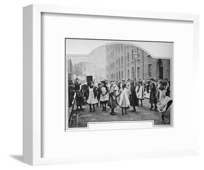 Dancing to a street organ, London, c1901 (1901)-Unknown-Framed Photographic Print