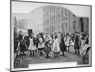 Dancing to a street organ, London, c1901 (1901)-Unknown-Mounted Photographic Print