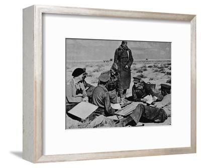 'Maps and plans are spread on the sand', 1942 (1944)-Unknown-Framed Photographic Print