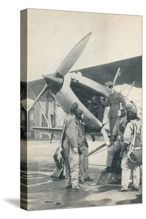 An instructor explaining engine details to a pupils at Sealand Aerodrome, Flintshire, c1936-Unknown-Stretched Canvas Print
