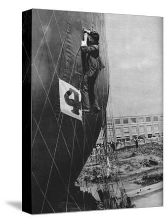 Making adjustments to the net of a balloon before attaching the basket, c1935 (c1937)-Unknown-Stretched Canvas Print