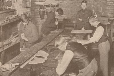 Boys of Harrow School making splints, crutches and other articles for the wounded, c1916-Unknown-Framed Photographic Print
