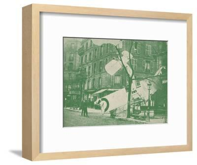 A French aeroplane descends in a Paris street, c1917 (1919)-Unknown-Framed Photographic Print