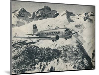 A Swissair plane flying near St Moritz Aerodrome, Switzerland, c1936 (c1937)-Unknown-Mounted Photographic Print