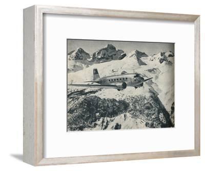 A Swissair plane flying near St Moritz Aerodrome, Switzerland, c1936 (c1937)-Unknown-Framed Photographic Print