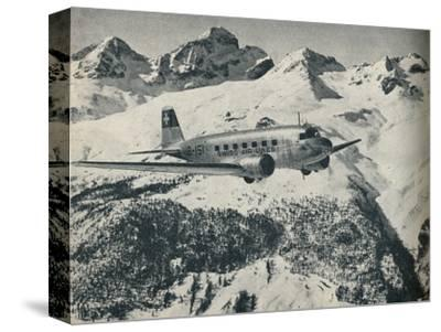 A Swissair plane flying near St Moritz Aerodrome, Switzerland, c1936 (c1937)-Unknown-Stretched Canvas Print