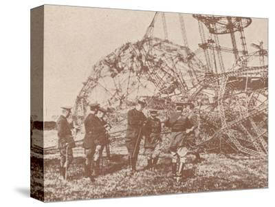 British staff officers examining the wreckage of a Zeppelin brought down in England, c1917-Unknown-Stretched Canvas Print