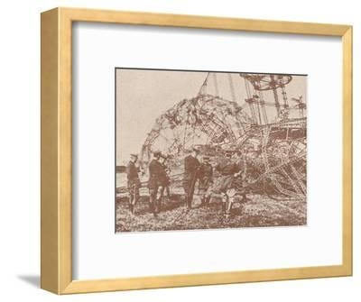 British staff officers examining the wreckage of a Zeppelin brought down in England, c1917-Unknown-Framed Photographic Print