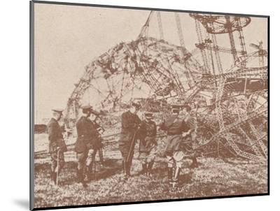 British staff officers examining the wreckage of a Zeppelin brought down in England, c1917-Unknown-Mounted Photographic Print