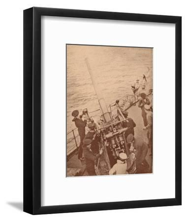 An anti-aircraft gun in action on a British battleship, c1917 (1919)-Unknown-Framed Photographic Print