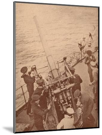 An anti-aircraft gun in action on a British battleship, c1917 (1919)-Unknown-Mounted Photographic Print