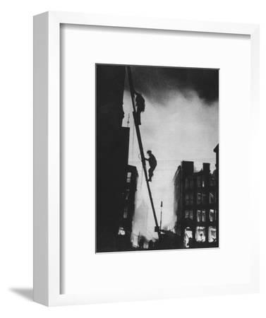 'Out in the Blitz, silhouetted aganinst the light of fires, rescue men climb into a building in St-Unknown-Framed Photographic Print