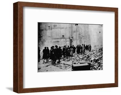 In the morning, work as usual. After a big raid, the way to the office is knee-deep in rubble-Unknown-Framed Photographic Print