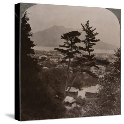 'Vista from hills above Kagoshima over Lake to distant Sakurajima volcano, Japan', 1904-Unknown-Stretched Canvas Print