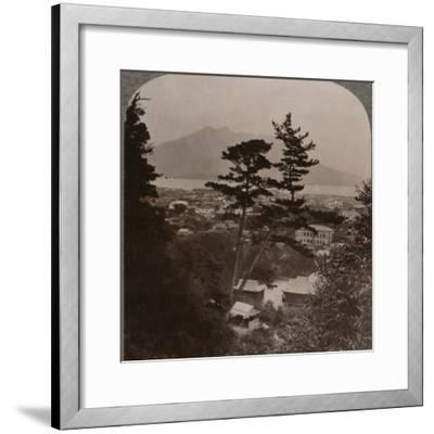 'Vista from hills above Kagoshima over Lake to distant Sakurajima volcano, Japan', 1904-Unknown-Framed Photographic Print
