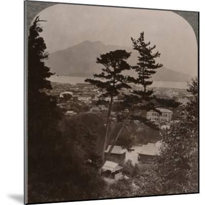 'Vista from hills above Kagoshima over Lake to distant Sakurajima volcano, Japan', 1904-Unknown-Mounted Photographic Print