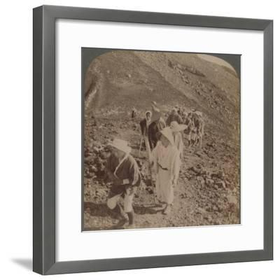 'Pilgrims, at end of weary ascent, in worship encircling crater of sacred Fujiyama, Japan', 1904-Unknown-Framed Photographic Print
