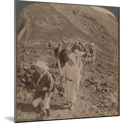 'Pilgrims, at end of weary ascent, in worship encircling crater of sacred Fujiyama, Japan', 1904-Unknown-Mounted Photographic Print