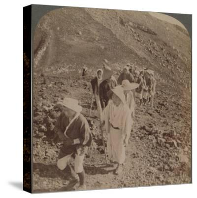 'Pilgrims, at end of weary ascent, in worship encircling crater of sacred Fujiyama, Japan', 1904-Unknown-Stretched Canvas Print