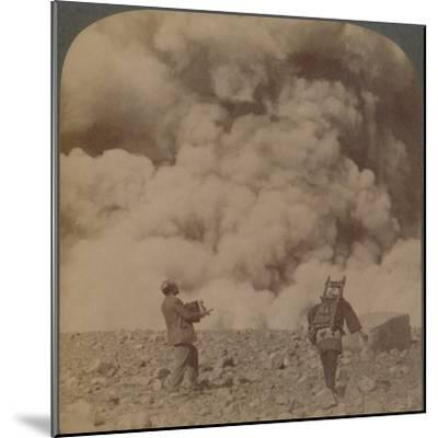 'Volcanic explosion - smoke, steam and stones thrown from crater of Asama-yama, Japan', 1904-Unknown-Mounted Photographic Print
