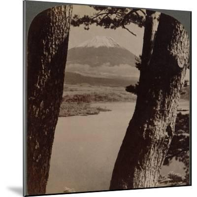 'Glorious Fuji, beloved by artists and poets, seen through pines at Lake Motosu, Japan', 1904-Unknown-Mounted Photographic Print