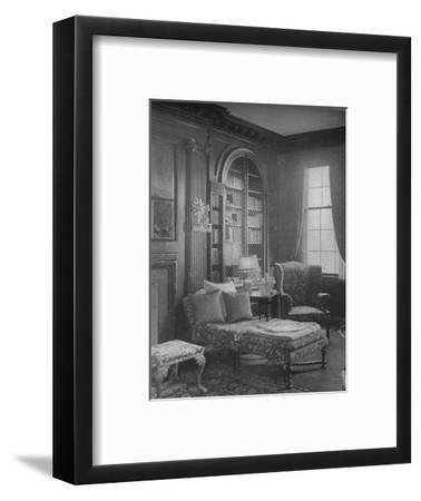 Comfortable corner in the library showing bookcase, house of Miss Anne Morgan, New York City, 1924-Unknown-Framed Photographic Print
