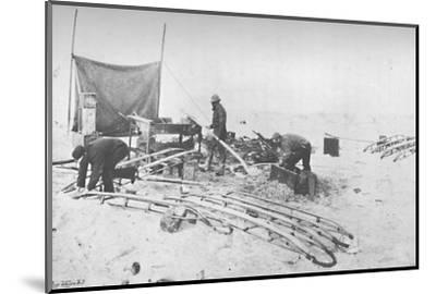 'Fitting the Hand-Sledges with Runners. July, 1895', (1897)-Unknown-Mounted Photographic Print
