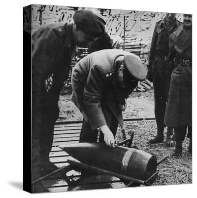 'Mr. Churchill autographing a present for Hitler', c1940s, (1945)-Unknown-Stretched Canvas Print