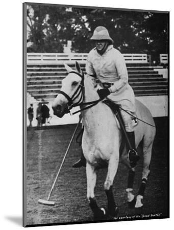 'Despite heavy responsibilities the favourite game of polo could not be neglected', c1930s, (1945)-Unknown-Mounted Photographic Print
