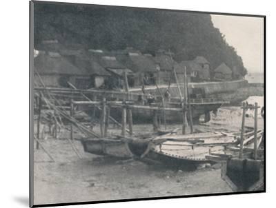'Tai-no-ura - Tiny houses on a margin of sand with fishing boats', c1900, (1921)-Julian Leonard Street-Mounted Photographic Print
