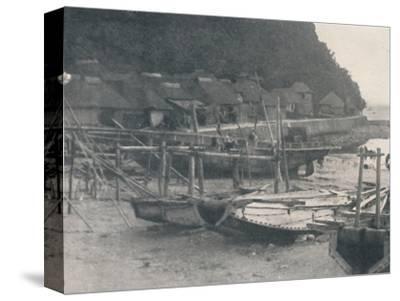 'Tai-no-ura - Tiny houses on a margin of sand with fishing boats', c1900, (1921)-Julian Leonard Street-Stretched Canvas Print