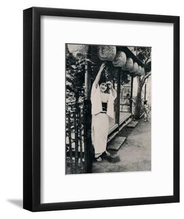 'Sweet natured smile of tea-house maid, called nesan - elder sister', c1900, (1921)-Julian Leonard Street-Framed Photographic Print