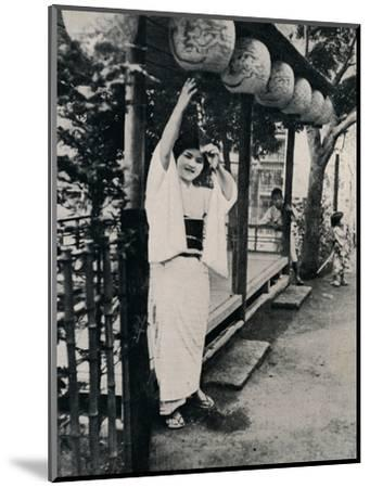 'Sweet natured smile of tea-house maid, called nesan - elder sister', c1900, (1921)-Julian Leonard Street-Mounted Photographic Print